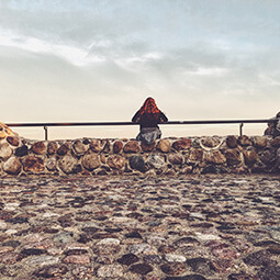 girl looking sea sky clouds rock stones solitude travel real social UGC photography