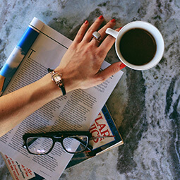 woman watch coffee fashion reading hand flat-lay magazine glasses branded UGC content