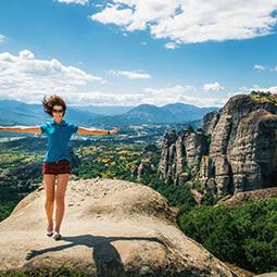 girl jump horizon rock mountains landscape blue hiking walking sport travel
